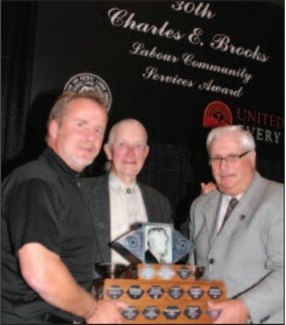Leslie Dickirson (centre)receiving the 2007 Charles E. Brooks Labour Service Community Award (source: The Guardian, December 2007)